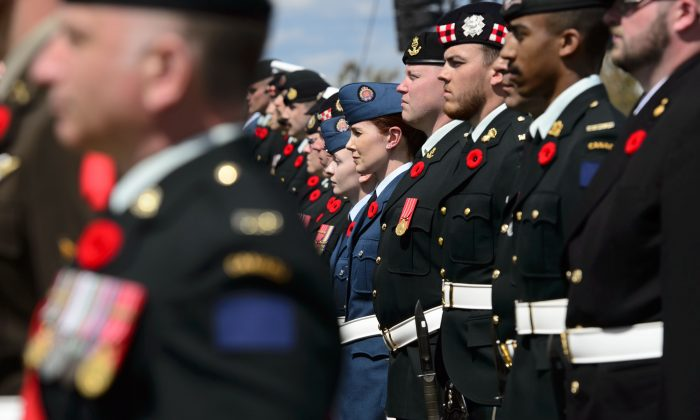 An honour guard takes part in the D-Day 75th Anniversary Canadian National Commemorative Ceremony at Juno Beach in Courseulles-Sur-Mer, France on Thursday, June 6, 2019. (Sean Kilpatrick/The Canadian Press)