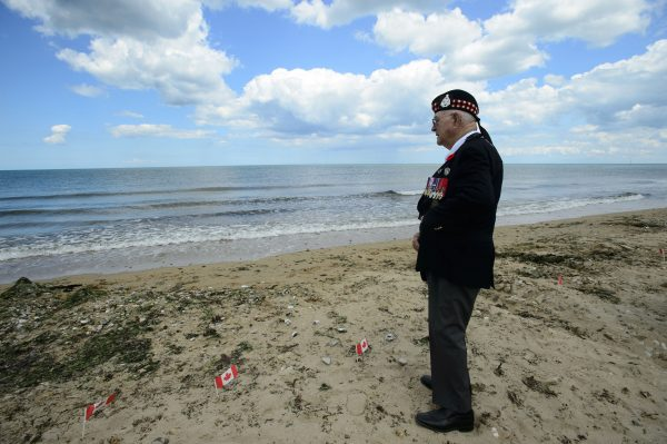Veteran of the Second World War Roy Hare stands and looks out from Juno Beach following the D-Day 75th Anniversary Canadian National Commemorative Ceremony at Juno Beach in Courseulles-Sur-Mer, France on June 6, 2019. (Sean Kilpatrick/The Canadian Press)