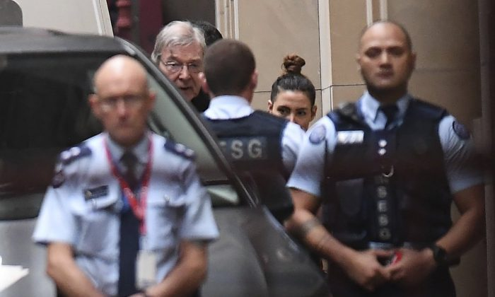 Cardinal George Pell, center rear, arrives at the Supreme Court of Victoria in Melbourne, on June 5, 2019. (Julian Smith/AAP Image via AP)