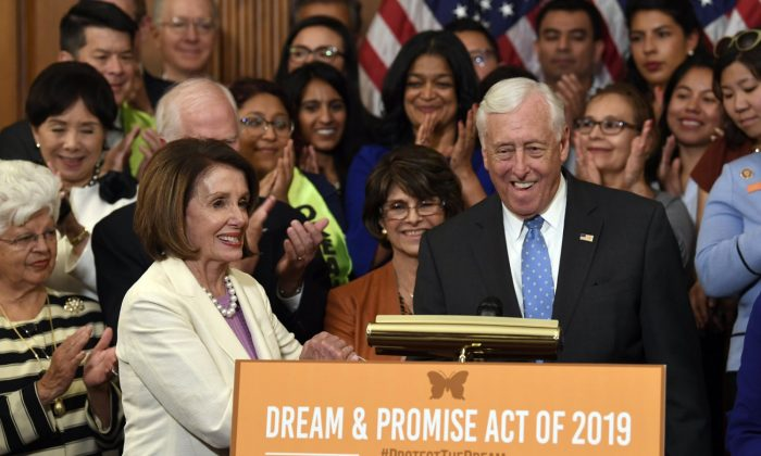 House Speaker Nancy Pelosi of Calif. (L) shakes hands with House Minority Whip Steny Hoyer, D-Md.  (R) on Capitol Hill in Washington, on June 4, 2019. (Susan Walsh/AP Photo)