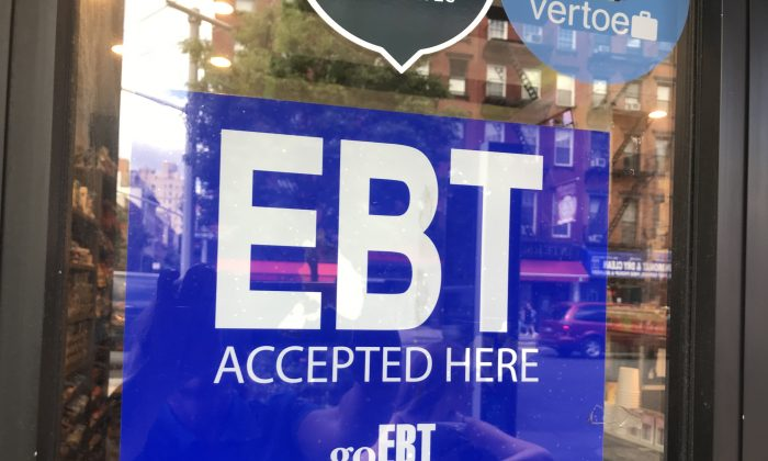 A store advertizes its acceptance of electronic benefit transfer cards in New York City on June 6, 2019. (Charlotte Cuthbertson/The Epoch Times)