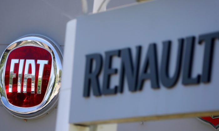 The logos of Renault and Fiat carmakers are seen in Nice, France on June 3, 2019. (Eric Gaillard/Reuters)