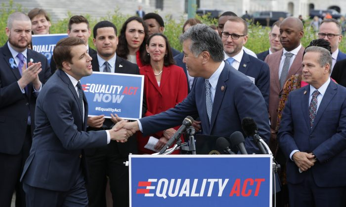 Rep. Mark Takano (D-CA) (C) welcomes Rep. Chris Pappas (D-NH) to the lectern during a rally and news conference with Rep. David Cicilline (D-RI) (R) and leaders from LGBTQ advocacy organizations before the House votes on the Equality Act May 17, 2019 in Washington, DC. The openly gay politicians and their supporters called on the Republican-controlled Senate to pass the Equality Act, which would modify existing civil rights law to extend anti-discrimination protections to LGBT Americans in employment, education, credit, jury service, federal funding, housing and public accommodations.  Chip Somodevilla/Getty Images