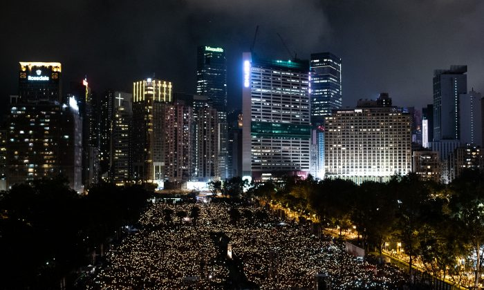 People attend a candlelight vigil at Victoria Park in Hong Kong on June 4, 2019, to mark the 30th anniversary of the 1989 Tiananmen Square massacre in Beijing. (PHILIP FONG/AFP/Getty Images)