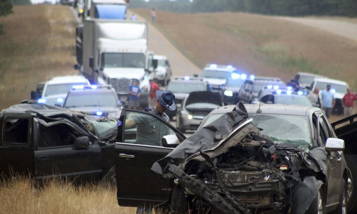 A Mississippi Highway Patrol state trooper investigates a wreck on U.S. Highway 45 south of Scooba in Kemper County, Miss., on June 5, 2019. (Bill Graham/The Meridian Star via AP)