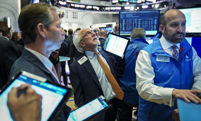 Traders and financial professionals work at the opening bell on the floor of the New York Stock Exchange on June 3, 2019. (Drew Angerer/Getty Images)