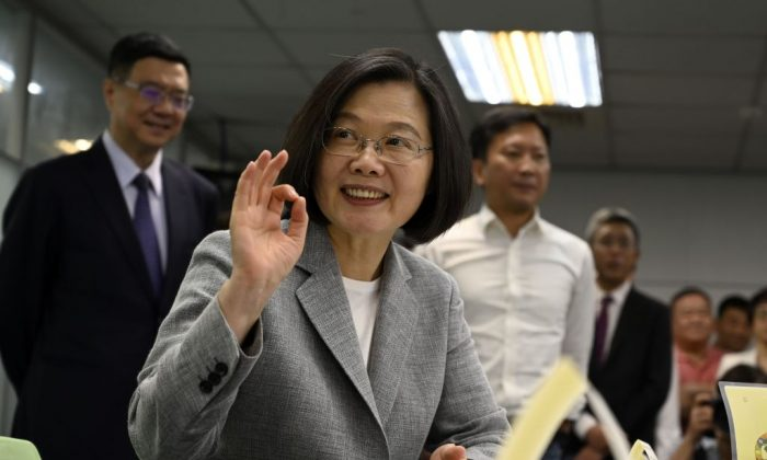 Taiwan's President Tsai Ing-wen gestures while registering as the ruling Democratic Progressive Party (DPP) 2020 presidential candidate at the party's headquarter in Taipei on March 21, 2019. (Sam Yeh/AFP/Getty Images)