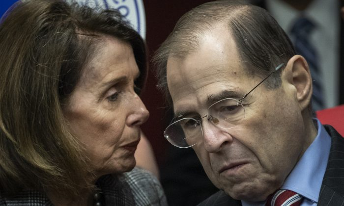 (L-R) Speaker of the House Nancy Pelosi (D-Calif.) speaks with House Judiciary Committee Chairman Rep. Jerry Nadler (D-N.Y.) during a press conference to discuss the American Dream and Promise Act at the Tenement Museum in New York City, March 20, 2019. Drew Angerer/Getty Images