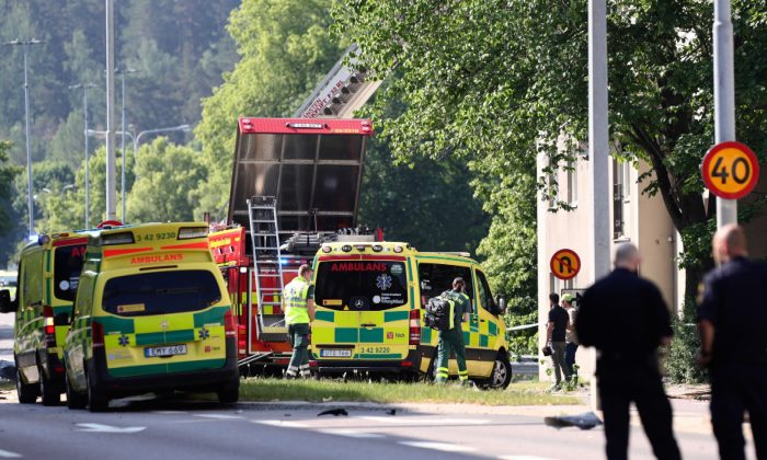 Rescue personnel are seen at the site of an explosion in Linkoping, Sweden on June 7, 2019. (Jeppe Gustafsson/TT News Agency/via Reuters)