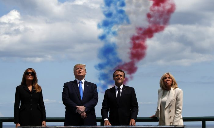 First lady Melania Trump, President Donald Trump, French President Emmanuel Macron and Brigitte Macron, watch a flyover during a ceremony to commemorate the 75th anniversary of D-Day at the American Normandy cemetery, in Colleville-sur-Mer, Normandy, France on June 6, 2019. (Alex Brandon/AP Photo)