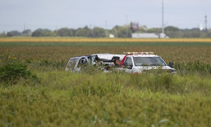 Law enforcement move a vehicle as they investigate a fatal wreck that left six migrants dead and several others injured outside Robstown, Texas on June 5, 2019. (Courtney Sacco/Corpus Christi Caller-Times via AP)