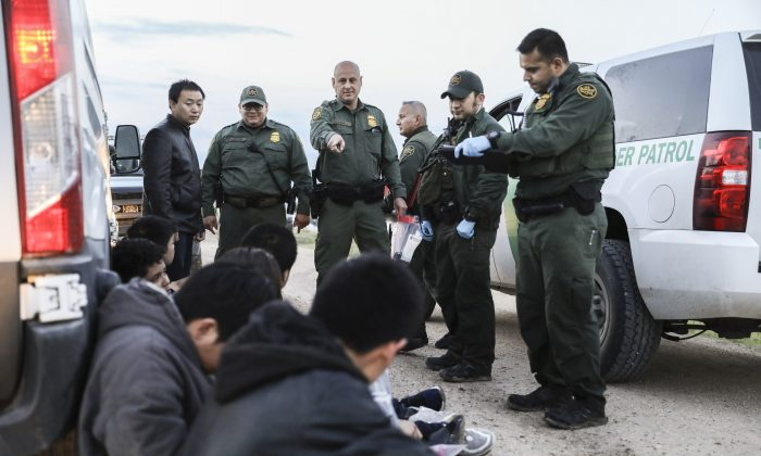 Border Patrol agents apprehend seven illegal immigrants from China, one from Mexico, and one from El Salvador after they tried to evade capture after crossing the Rio Grande from Mexico into the United States near McAllen, Texas, on April 18, 2019. (Charlotte Cuthbertson/The Epoch Times)