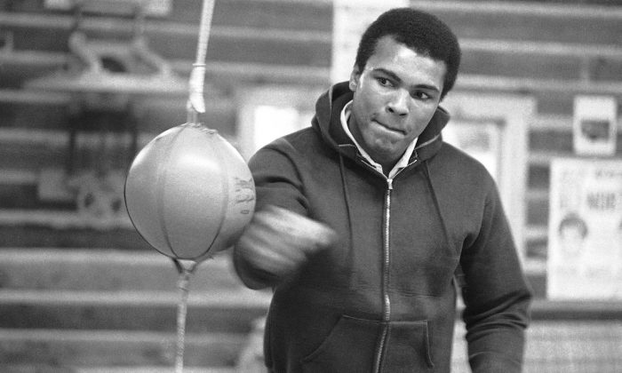 Muhammad Ali punches a bag in his Deer Lake, Pa., training camp where he was preparing for his rematch with Joe Frazier, on Jan.10, 1974. (Rusty Kennedy/AP Photo)