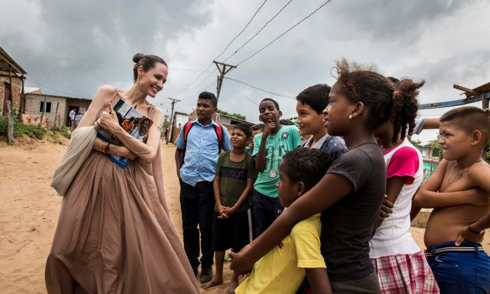 Special envoy for the United Nations High Commissioner for Refugees Angelina Jolie speaks to people in Riohacha, Colombia on June 7, 2019. (UNHCR/Andrew McConnell/Handout via Reuters)