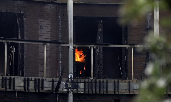 The interior of a flat burns after a fire broke out in Barking, London, Britain, on June 9, 2019. (Simon Dawson/Reuters)