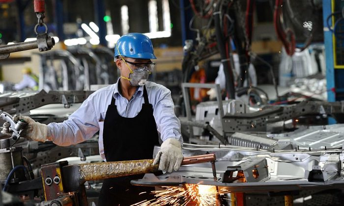 A worker welds in the body shop at the Ford automotive plant in the Hai Duong, Vietnam, on Jan. 11, 2017. (HOANG DINH NAM/AFP/Getty Images)
