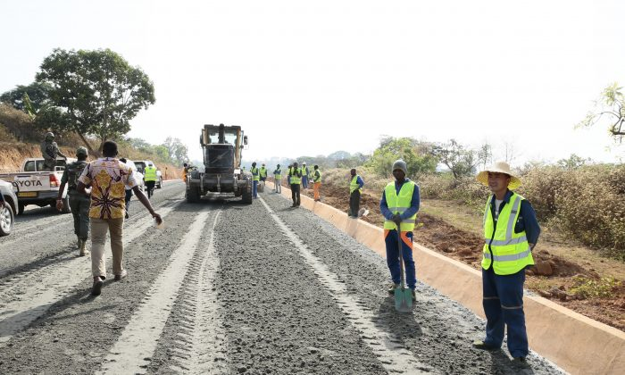 A road under construction with ballast stone from a quarry set up by a Chinese state-owned company. Residents of Yoko—the town near which the quarry is set up—report that their homes is being damaged due to vibrations caused by the quarry. (Amindeh Blaise Atabong for The Epoch Times)