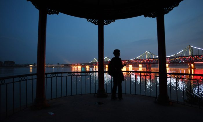 A woman looking at a bridge in China. (Greg Baker/AFP/Getty Images)