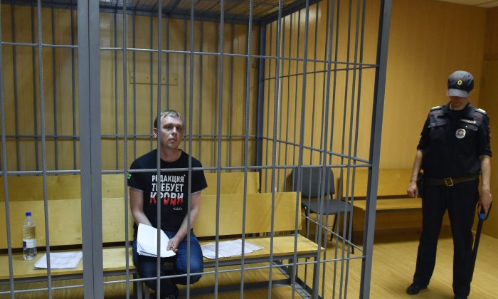Russian investigative journalist Ivan Golunov, charged with attempted drug-dealing, sits inside a defendants' cage during a hearing at a court in Moscow on June 8, 2019.  VASILY MAXIMOV/AFP/Getty Images
