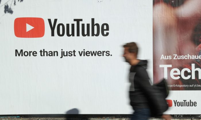 A man walks past a billboard advertisement for YouTube on October 5, 2018, in Berlin. (Sean Gallup/Getty Images)