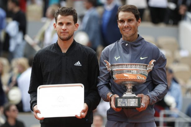 Spain's Rafael Nadal and Austria's Dominic Thiem pose with their trophies at the Roland Garros stadium in Paris, on June 9, 2019. (Vincent Kessler/Reuters)