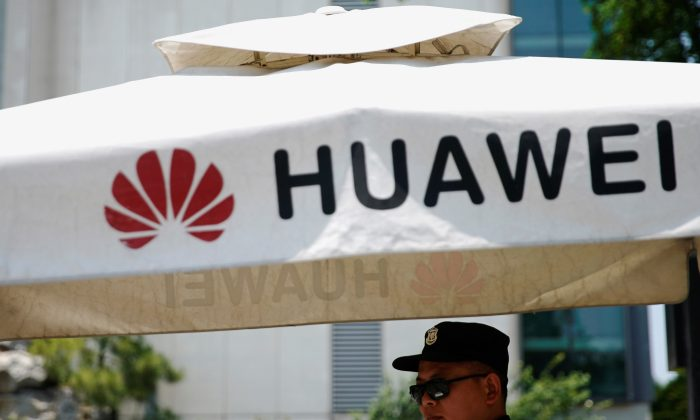 A Huawei company logo is seen at Huawei's Shanghai Research Center in Shanghai, China, on May 22, 2019. (Aly Song/Reuters)