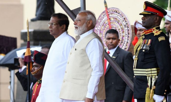 Indian Prime Minister Narendra Modi (C) and Sri Lankan President Maithripala Sirisena (L) attend a welcoming ceremony for Modi at the Presidential Secretariat, in Colombo on June 9, 2019. (Lakruwan Wanniarachchi/AFP/Getty Images)