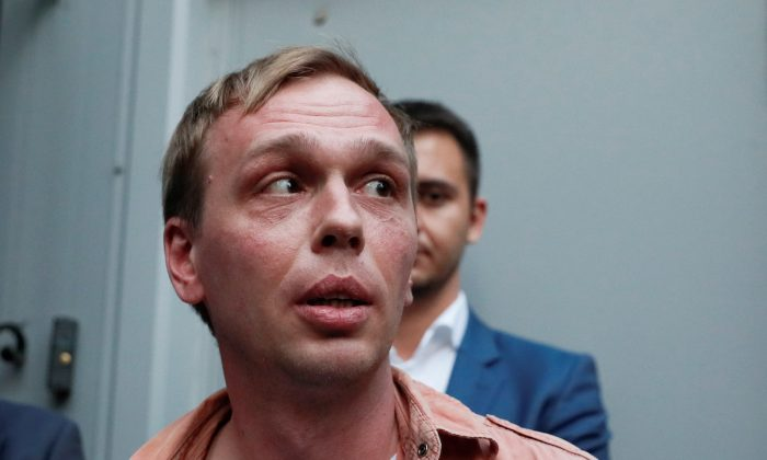 Russian journalist Ivan Golunov, who was freed from house arrest after police abruptly dropped drugs charges against him, speaks with the media near an office of criminal investigations in Moscow, Russia on June 11, 2019. (Shamil Zhumatov/Reuters)