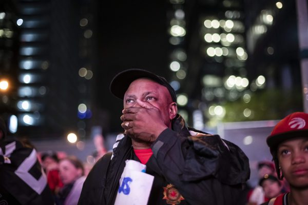 Raptors fans react outside of Scotiabank Arena after the Toronto Raptors lost Game 5 of the NBA Final to the Golden State Warriors in Toronto, on Monday, June 10, 2019. (Christopher Katsarov/The Canadian Press)