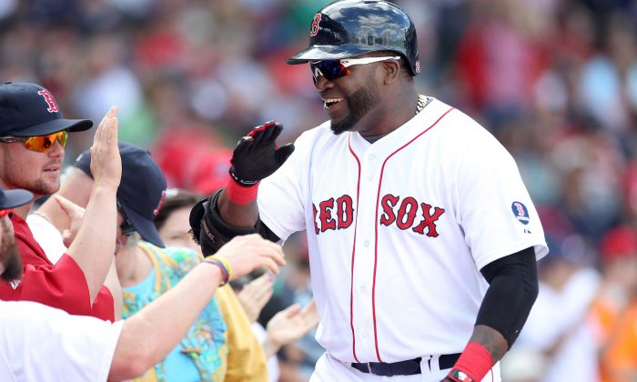 Boston Red Sox designated hitter David Ortiz celebrates his solo home in the sixth inning against the Toronto Blue Jays during their MLB American League East baseball game in Boston, Massachusetts, Sept. 22, 2013. (Dominick Reuter/Reuters)