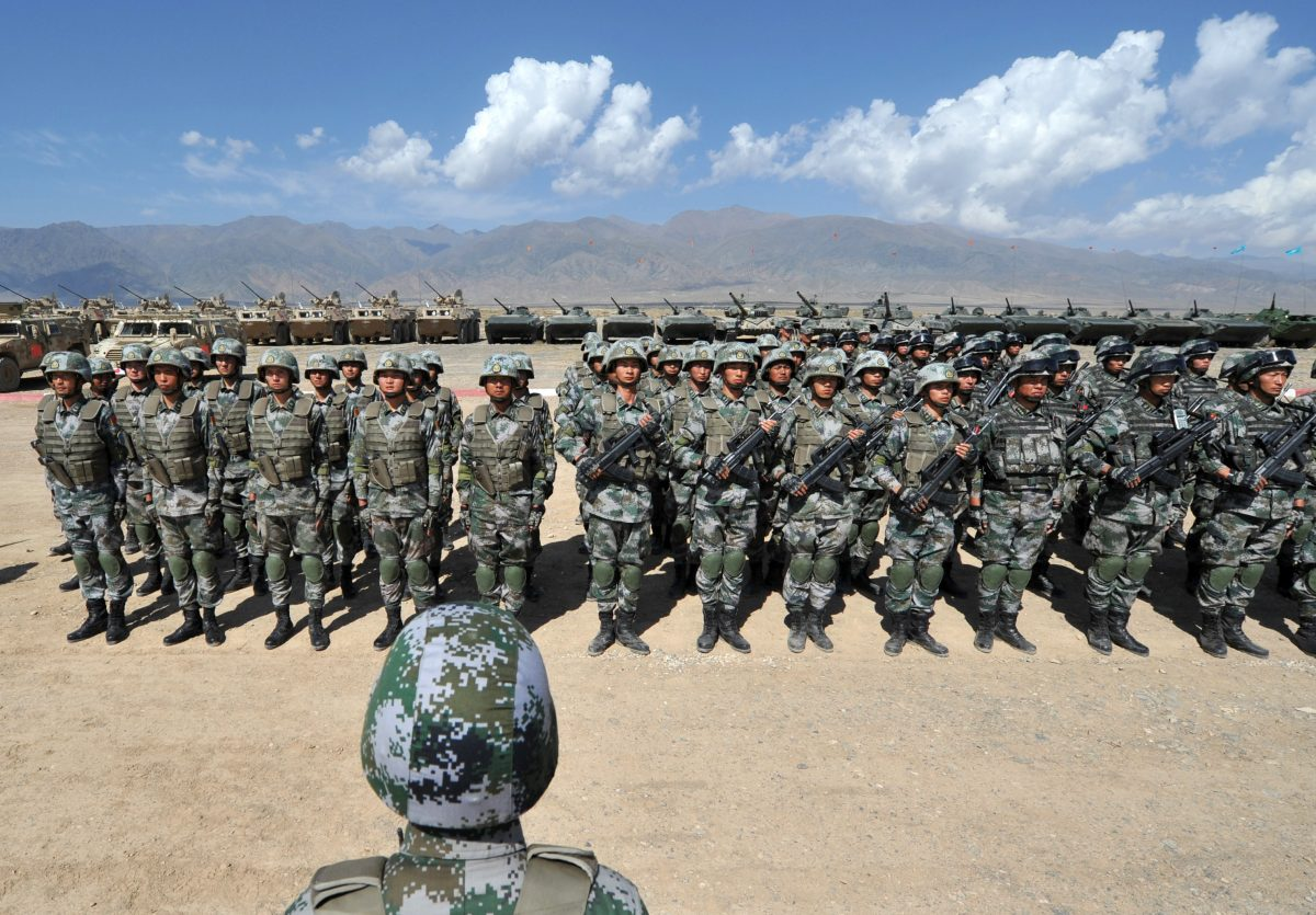 Chinese soldiers stand at attention during Peace Mission-2016 joint military exercises of the Shanghai Cooperation Organization (SCO) in Balykchy, Kyrgyzstan, on Sept. 19, 2016. The joint antiterrorism drill involves more than 1,100 troops from Russia, Kazakhstan, Kyrgyzstan, Tajikistan, Uzbekistan, and China as members of the Shanghai Cooperation Organization. (VYACHESLAV OSELEDKO/AFP/Getty Images)