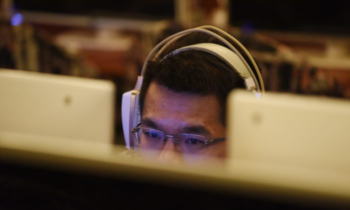 A man uses a computer in an internet cafe in Beijing, China, on June 1, 2017. (Greg Baker/AFP/Getty Images)