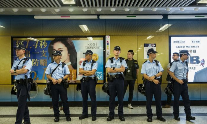 Police stand guard inside Admiralty MTR station in Hong Kong on June 11, 2019. (Isaac Lawrence/AFP/Getty Images)