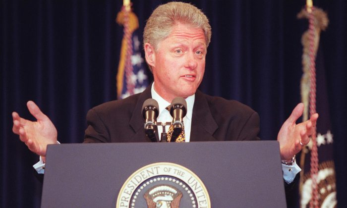 President Bill Clinton responds to questions at the White House after announcing his decision to grant most favored nation status to China for another year, on May 19, 1997. JAMAL WILSON/AFP/Getty Images