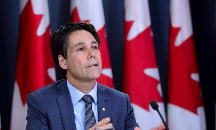 Dr. Eric Hoskins, Chair of the Advisory Council on the Implementation of National Pharmacare, speaks during a press conference at the National Press Theatre in Ottawa on June 12, 2019. (Sean Kilpatrick/The Canadian Press)