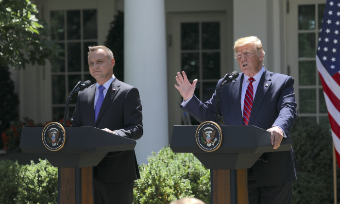 President Donald Trump and Poland President Andrzej Duda (L) during a press conference in the White House Rose Garden in Washington on June 12, 2019. (Charlotte Cuthbertson/The Epoch Times)