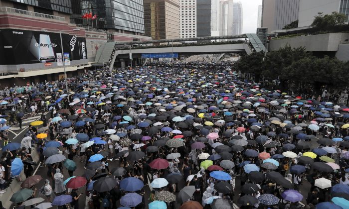 Protestors gather near the Legislative Council in Hong Kong, on June 12, 2019. (Kin Cheung/AP)