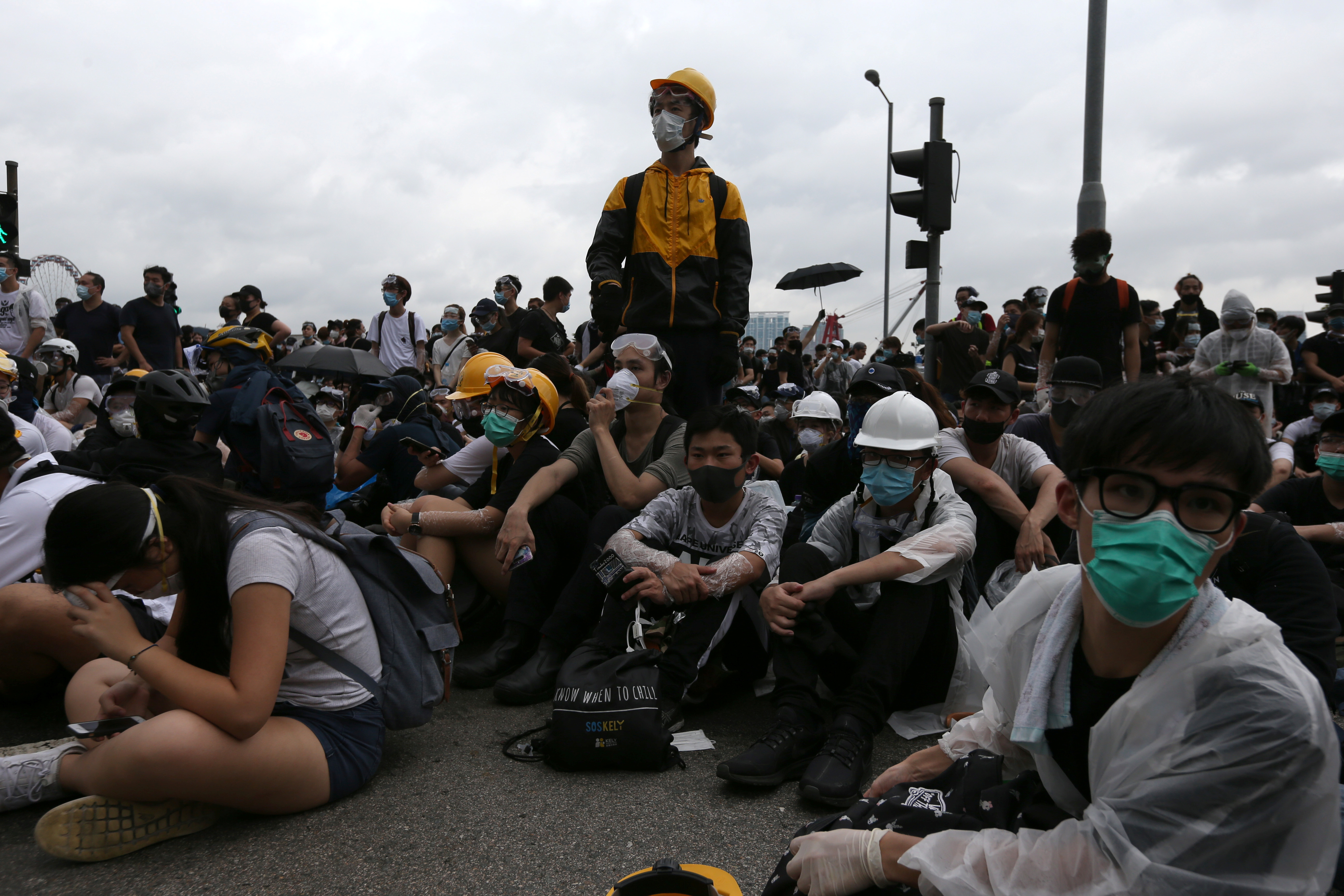 Protesters occupy a road as they demonstrate