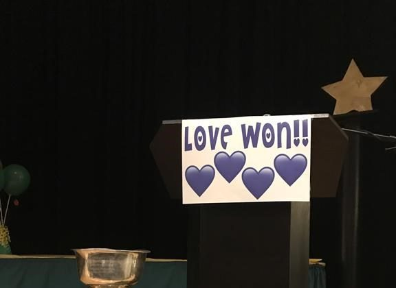 A Love Won sign is shown at the Amherst Regional High School athletics awards night in Amherst, N.S., in this handout photo. (HO - Amherst Regional High School, Aaron Stubbert/The Canadian Press)