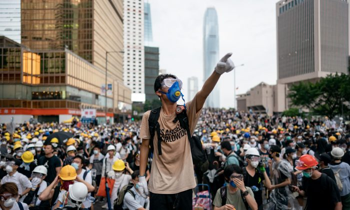 A protester makes a gesture during a protest on June 12, 2019 in Hong Kong China. Large crowds of protesters gathered in central Hong Kong as the city braced for another mass rally in a show of strength against the government over a divisive plan to allow extraditions to China. (Anthony Kwan/Getty Images)
