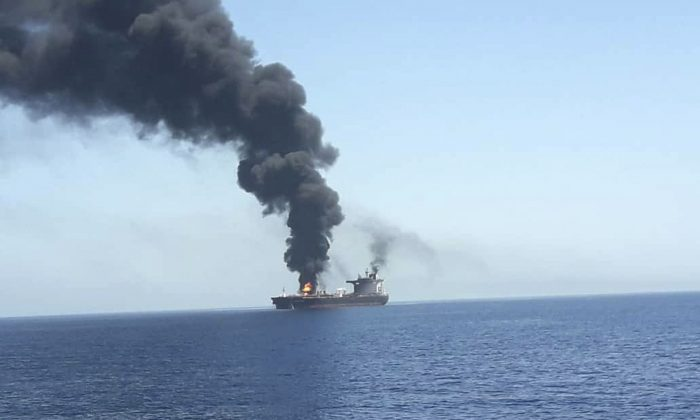 In this photo released by state-run IRIB News Agency, an oil tanker is on fire in the sea of Oman on June 13, 2019. (IRIB News Agency via AP)
