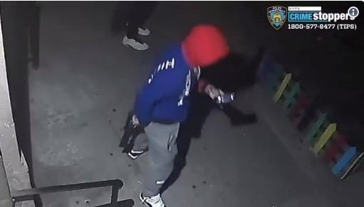 gunman holds gun