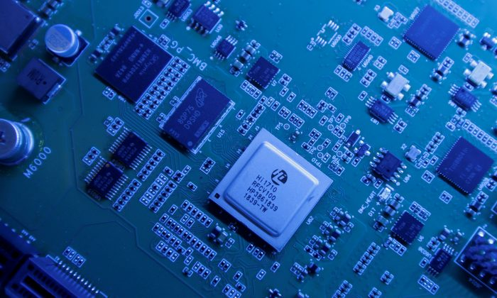 Hi1710 BMC management chip is seen on a Kunpeng 920 chipset designed by Huawei's Hisilicon subsidiary is on display at Huawei's headquarters in Shenzhen, Guangdong Province, China on May 29, 2019. (Jason Lee/Reuters)