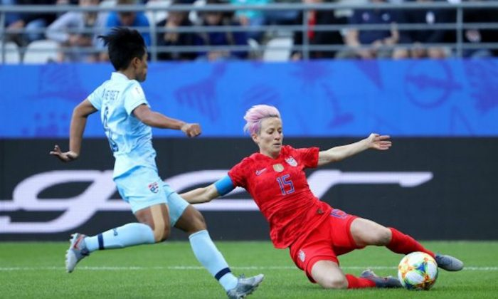 Megan Rapinoe of the USA slides to control the ball during the 2019 FIFA Women's World Cup France group F match between USA and Thailand at Stade Auguste Delaune in Reims, France on June 11, 2019. (Robert Cianflone/Getty Images)