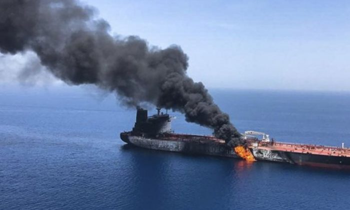 An oil tanker is on fire in the sea of Oman, Thursday, June 13, 2019. Two oil tankers near the strategic Strait of Hormuz were reportedly attacked on Thursday, an assault that left one ablaze and adrift as sailors were evacuated from both vessels and the U.S. Navy rushed to assist amid heightened tensions between Washington and Tehran. (ISNA/AP Photo)