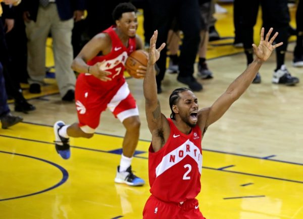 Raptors forward Kawhi Leonard (2) and Toronto Raptors guard Kyle Lowry (7) celebrate winning the NBA Championship over the Golden State Warriors against game six of the 2019 NBA Finals at Oracle Arena on June 13, 2019. (Sergio Estrada-USA TODAY Sports/The Canadian Press)