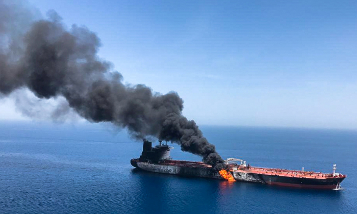 An oil tanker is seen after it was attacked at the Gulf of Oman, in waters between Gulf Arab states and Iran, June 13, 2019. (ISNA/Handout via REUTERS)