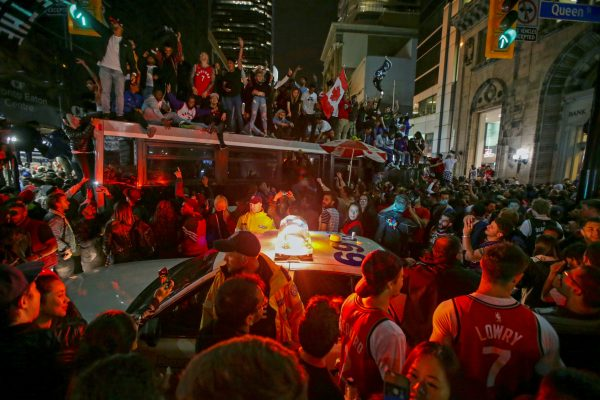 Fans celebrate in the streets of Toronto, Canada after the Toronto Raptors win the NBA Championship in Toronto, Ontario, Canada, June 13, 2019. (Chris Helgren/Reuters)
