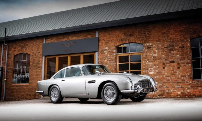 "A fully restored version of the Aston Martin DB5, made famous by suave spy James Bond in the 1964 film ""Goldfinger,"" is going up for auction. (CNN)"