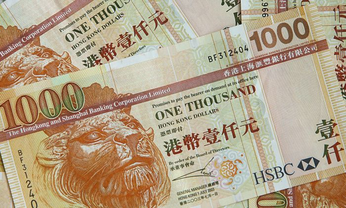 A genuine 1,000 Hong Kong dollar banknotes (worth appx 130 USD each). (MIKE CLARKE/AFP/Getty Images)